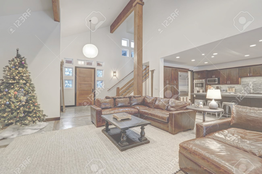 Amazing Vaulted Ceiling Living Room Accented With Wood Beams Over Brown regarding Lovely Vaulted Ceiling Living Room