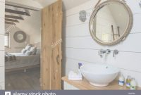 Elite Painted White Wooden Planks And Nautical Style Mirror In Ensuite for Awesome Nautical Mirror Bathroom