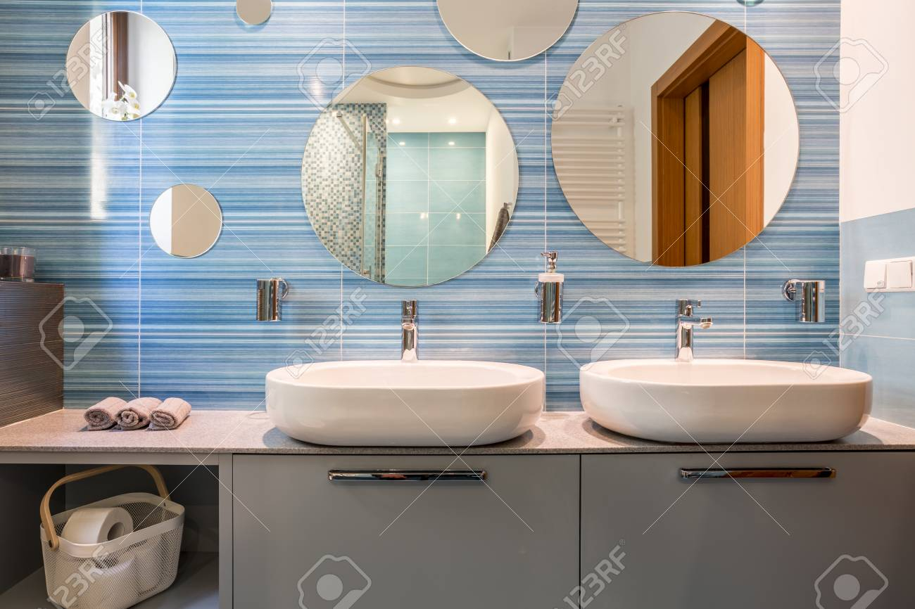 Epic Blue Bathroom With Two Sinks And Oval Mirrors Stock Photo, Picture regarding Oval Room Blue Bathroom