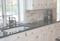 Fabulous White Cabinets Black Countertops And That Faucet | City Heights in Luxury Black Countertop Kitchen