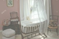 Glamorous White Voile Drapes On A Victorian Style Rocking Cradle In Eighties inside Victorian Style Nursery