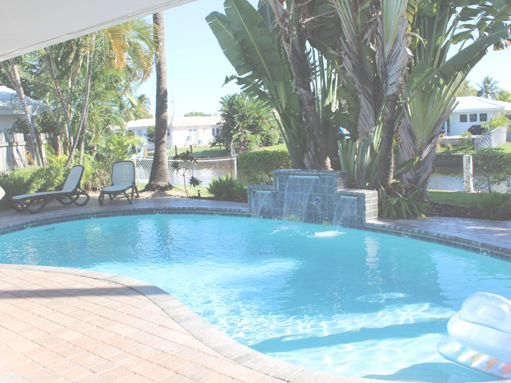 Lovely Backyard Paradise: 2Bd/2Bath Waterfront Home With Pool, Tiki Bar within Lovely Backyard Paradise