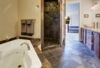 Modern Bathroom Interior With Dark Tile Floor And Tile Shower Trim Stock inside Beautiful Dark Bathroom Vanity
