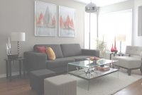 Modern Grey Sofa Living Room Beautiful White Frames Above Dark Grey Sofa regarding Living Room With Grey Walls