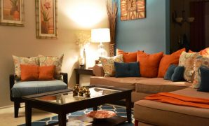 Modular Rugs, Coffee Table, Pillows, Teal, Orange, Living Room Behr Paint inside Orange Living Room