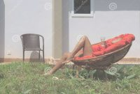 Glamorous Large Backyard With A Lawn And Chairs Stock Photo – Image Of Chairs within Backyard Sunbathing