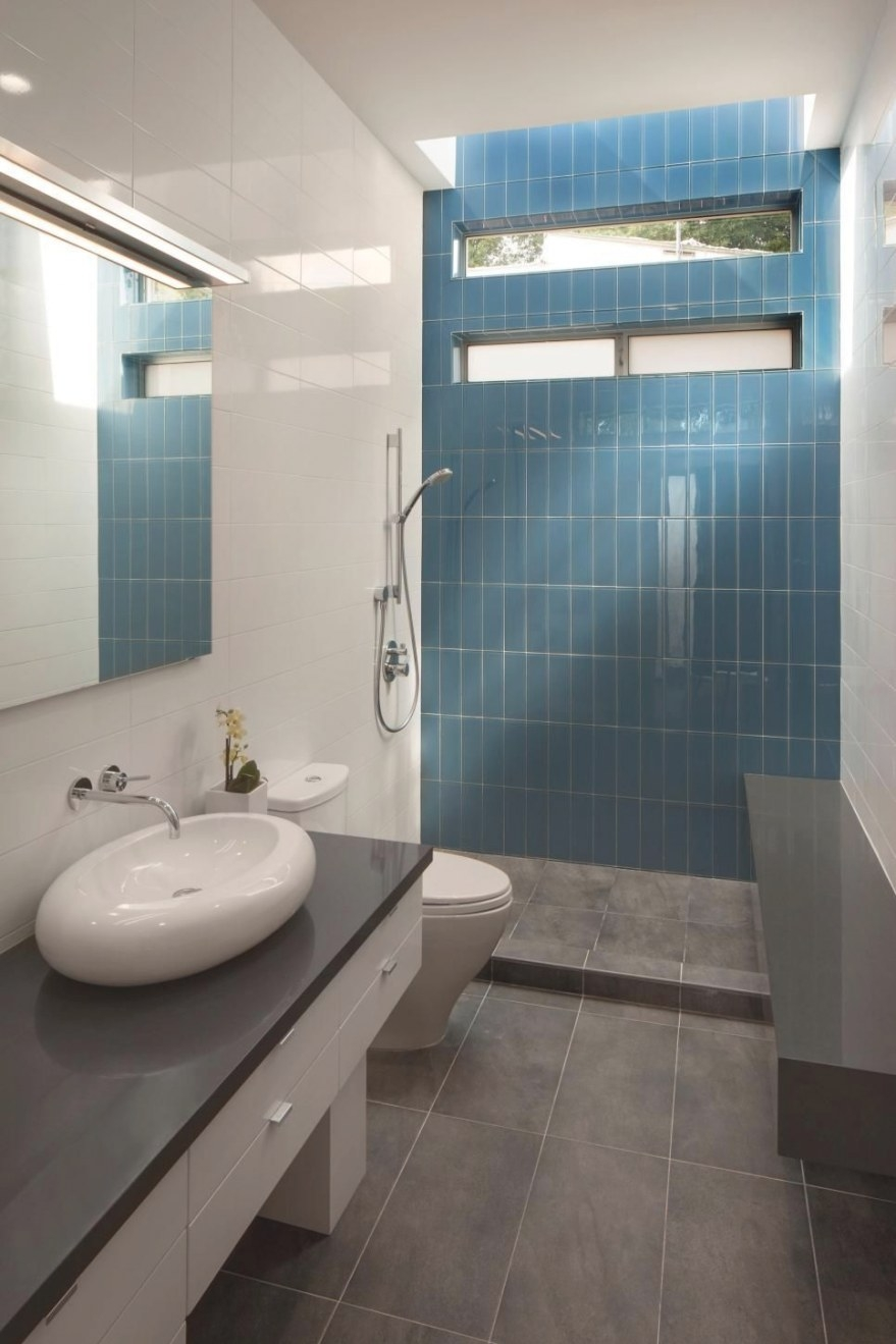 A Bright Blue Tile Accent Wall At The Back Of The Shower with Accent Walls In Bathrooms