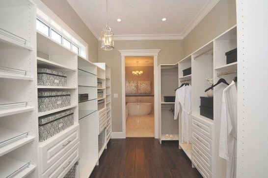 A Custom Built Walk In Closet With Glass Shelves, Shoe with regard to Walk Through Closet To Bathroom