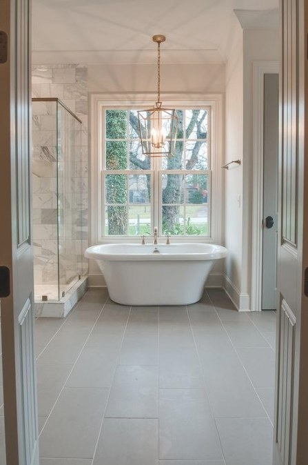 Brass Lantern Over Tub And Gray Porcelain Floor Tiles inside Porcelain Tiles For Bathrooms
