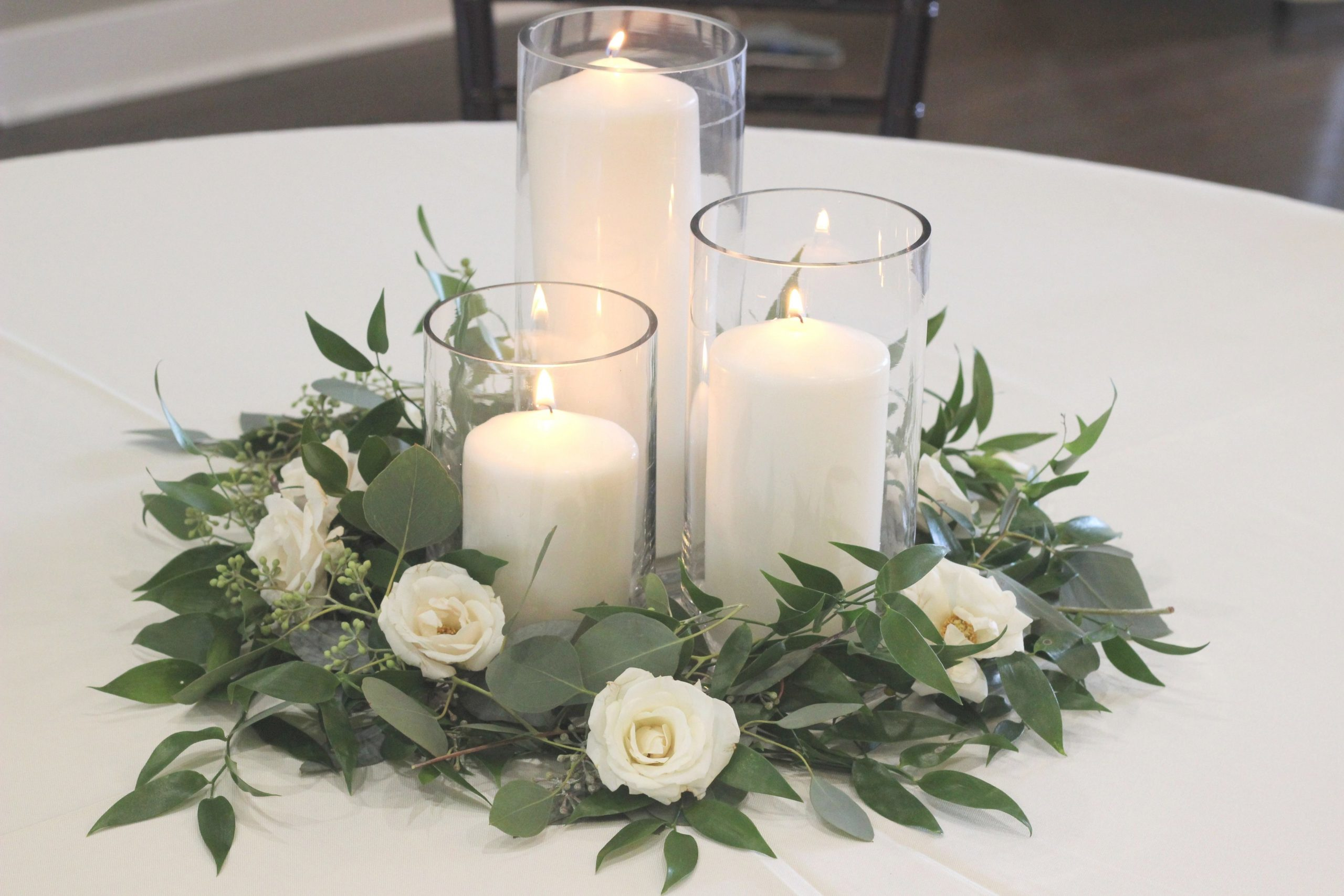 Greenery And Spray Rose Centerpiece With Pillar Candles with regard to Candle Decoration With Flowers