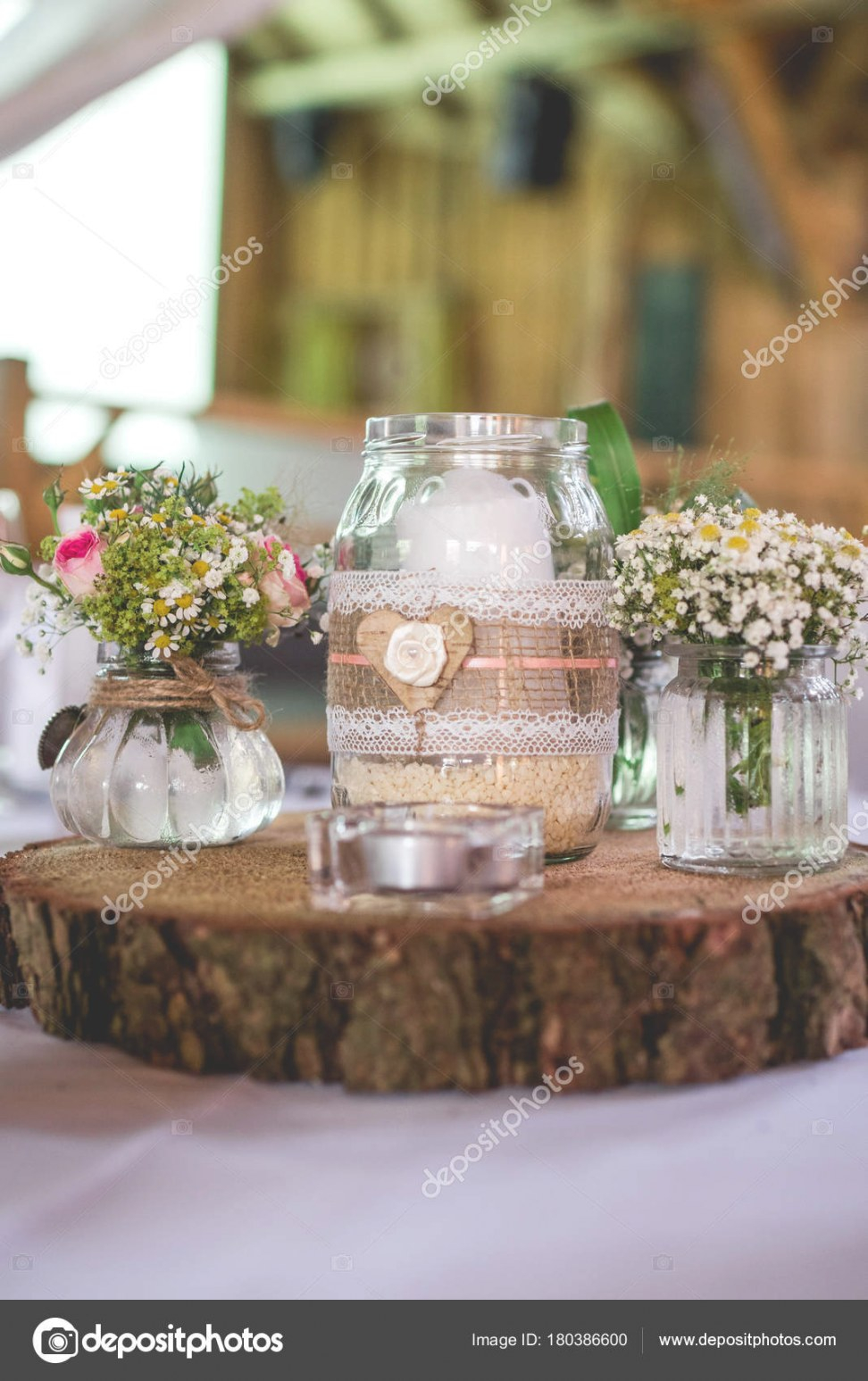 Romantic Wedding Decoration With Flowers And Candle On A Wooden Plate  180386600 within Candle Decoration With Flowers