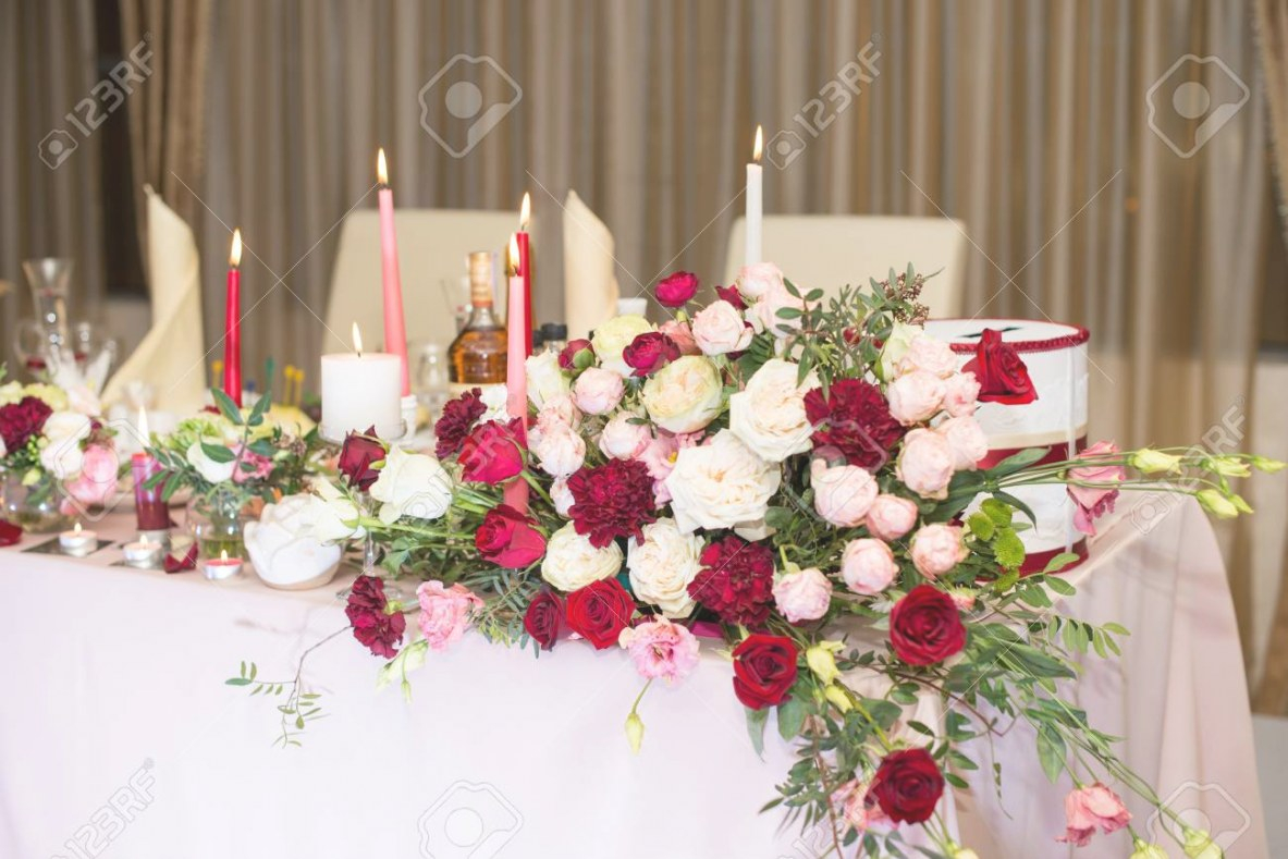 Wedding Table Decor With Red Flowers And Candles. within Candle Decoration With Flowers