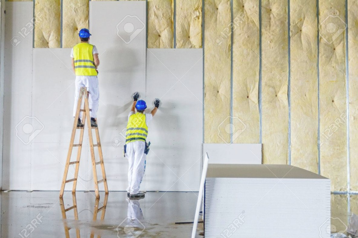 Workers Are Assembly Gypsum Wall. Plasterboard Is Under Construction.. inside Plasterboard